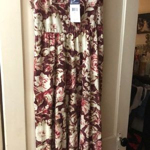 Sleeveless dress, brand new,never worn.